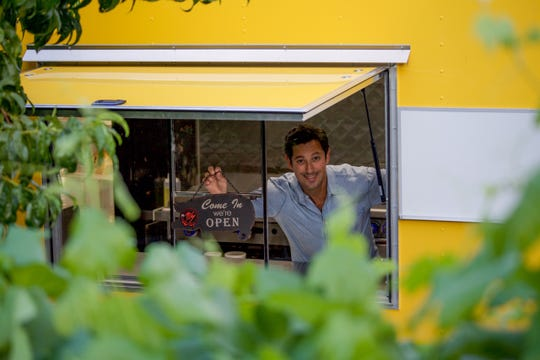 Ryan Goldhammer, co-owner of Pignic Pub & Patio, takes a moment in the Pig Shack Eatery kitchen trailer. The trailer anchors the new Pig Shack Eatery restaurant at Pignic on Flint Street in Reno.