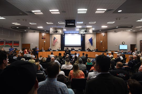 It was standing room only at an Aug. 5 workshop of the Reno City Council, where a moritorium on new building in the Lemmon Valley area and an appeal of a jury ruling that named the city liable for damage to homes and property surrounding Swan Lake were weighed.