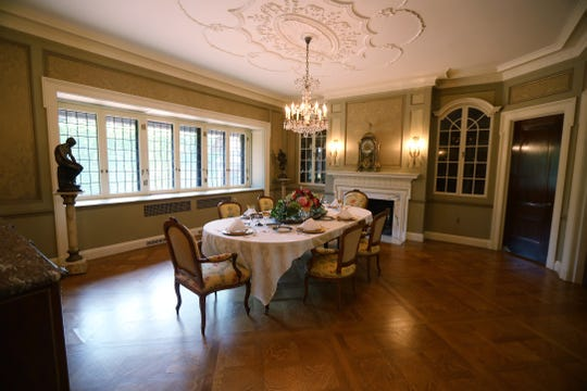 The Twin Gables dining room has a hidden storage area with a safe.