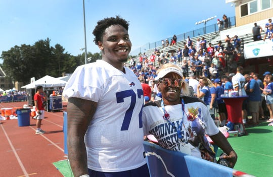 Jarron Jones poses with his mother, Lakiescha, following his first practice at St. John Fisher College as a member of the Buffalo Bills.