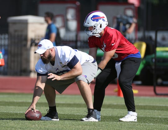 Center Mitch Morse, shown working with backup quarterback Matt Barkley,  was signed to solidify the middle of the Buffalo Bills offensive line.