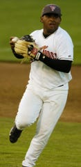 Volcanoes third baseman Pablo Sandoval throws to first against the Spokane Indians Tuesday night 8/23/05.