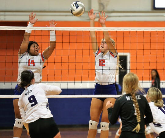 San Angelo Central High School's Veronica Guerrero (14) and Presley Knowlton try to block a shot by Abilene Wylie's Keetyn Davis during the season-opening volleyball match at Central's Trevino gym on Tuesday, Aug. 6, 2019. Wylie won in four sets.