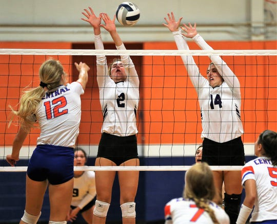 San Angelo Central's Presley Knowlton (12) fires a shot past Abilene Wylie's Avery Wimberly (2) and Maggie Allen  during the volleyball season opener at Central's Trevino gym on Tuesday, Aug. 6, 2019.