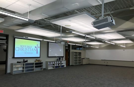Shown are two of four new classrooms inside the high school portion of the Sioux Falls Christian Schools campus. The classrooms, which can be divided in half or combined as one for collaboration, are part of a larger expansion to the high school side of the campus that will be ready for students by the first day of school.