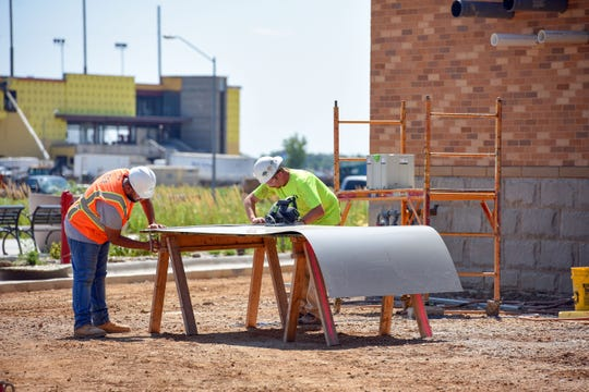 Construction workers make headway on the new Summit League office building on Tuesday, August 6, at the Sanford Sports Complex.