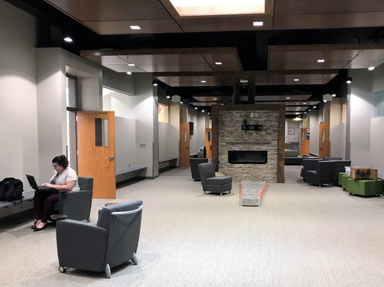 A woman works Monday, Aug. 5, 2019, in the new commons area of the high school portion of the Sioux Falls Christian Schools campus. The area is part of a larger expansion to the high school side of the campus that will be ready for students by the first day of school.