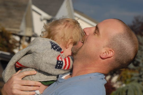 Chad McConnell holds his son, Casey, outside his Harrisburg, Pa., home in 2007.