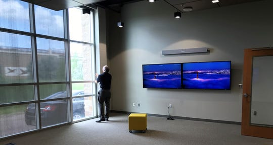Principal Jeremy Van Nieuwenhuyzen opens windows Monday, Aug. 5, 2019, in a new student-focused board room at the high school portion of the Sioux Falls  Christian Schools campus. The room is one of several added as an expansion to the school, expected to be complete by the beginning of the new school year.