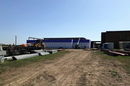 Builders work on the outer walls of Harrisburg High School's new Freshmen Academy as part of an ongoing expansion to the campus, expected to be complete by fall 2020.