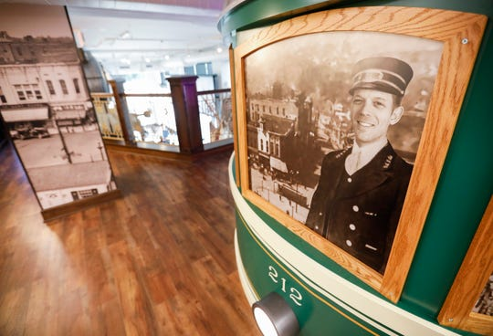 "A picture of Jeff Houghton, host of ""The Mystery Hour,"" decorates the outside of a replica streetcar at the History Museum on the Square. The museum is located at 154 Park Central Square and will have its grand opening on Thursday, Aug. 8, 2019."