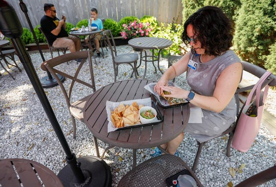Stormy Bultas prepares to eat a taco on the outside patio at Team Taco on Tuesday, Aug. 6, 2019 in Springfield, Mo. Team Taco is located at 1454 E. Cherry St.