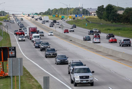 Traffic backs up past Chestnut Expressway on southbound U.S. Highway 65 as drivers line up to exit onto Sunshine Street on Monday, Aug. 5, 2019.