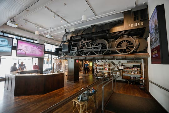 A three-quarter scale Frisco Railway steam engine looms above the lobby at the History Museum at the Square. The museum is located at 154 Park Central Square and will have its grand opening on Thursday, Aug. 8, 2019.