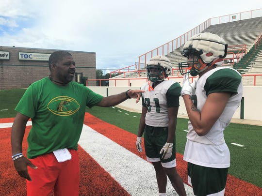 FAMU tight ends coach James Spady discusses sequences with true freshmen Kamari Young (81) and Kaloeb Parker. The first-year Rattlers are expected to see major playing time this season.