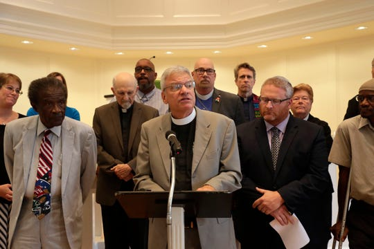 Rev. Brant Copeland from First Presbyterian Church speaks at a press conference, uniting against gun violence, with other religious leaders from the community Tuesday, Aug. 6, 2019.