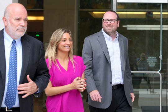 J.T. Burnette, who was indicted for the FBI's long-running public corruption probe, right, and his legal team leave the Federal Courthouse after a motion for a later trial date was denied Tuesday, Aug. 6, 2019.