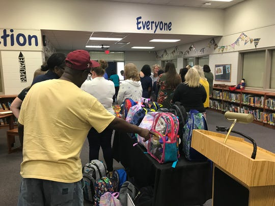 Scott & Wallace donated 25 stocks backpacks to Conley Elementary School.