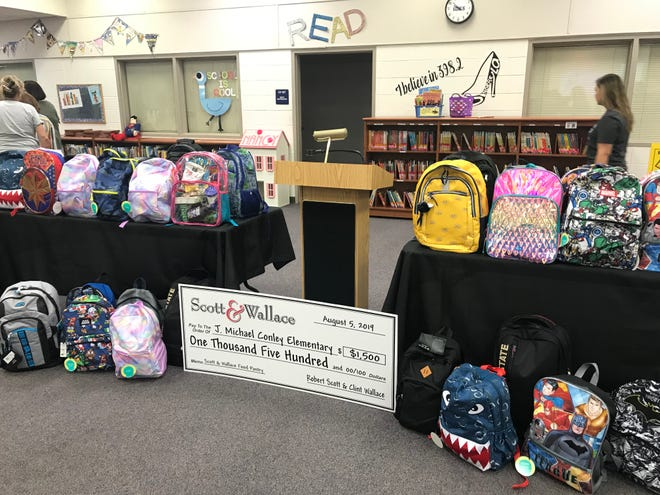 Scott & Wallace made a donated money and school supplies to Conley Elementary School.