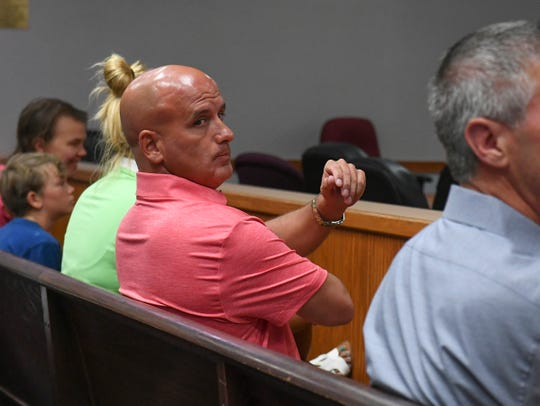 Michael Woodberry sits with his friend Elizabeth Bell (left) inside the St. Lucie County Courthouse on Tuesday, Aug. 6, 2019, while waiting to stand before Judge Kathryn Nelson on a charge of selling beer without a license to undercover investigators at the St. Lucie Golf Range in Fort Pierce. Woodbury pleaded not guilty to one count of selling alcoholic beverages without a license. His next appearance will be on Monday, Sept. 9, 2019.