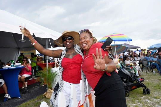 Chanel Bradley, left, and Tina Dixon at the Caribbean American Cultural Group's Jerk Festival at the Causeway Cove Marina in Fort Pierce.