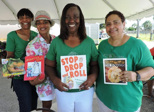 Jovita Williams, left, Arnater Dowers, Thelma Washington and Taunya Bryant of The LINKS Inc. at the Back to School Bash in East Stuart.