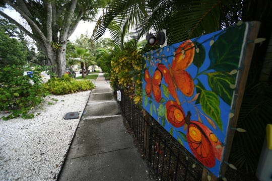 A mural decorates a fence in the 1900 block of 19th Avenue, one of several murals decorating front yards in the  Edgewood neighborhood in Vero Beach, directly south of State Road 60.