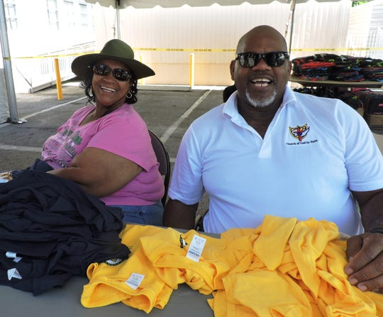 Diane Hawkins, left, and Jimmy Washington of Love Temple distributed Spirit Shirts for J.D. Parker Elementary School at the Back to School Bash in East Stuart.