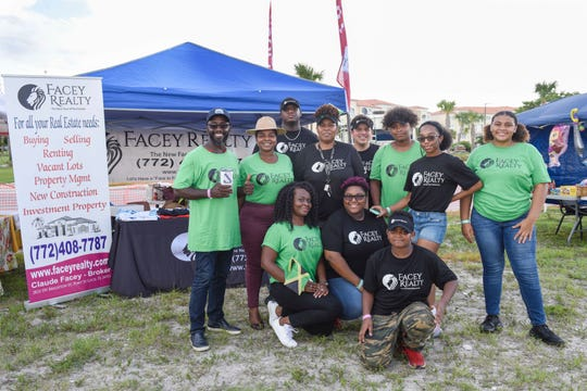 The Facey Realty team at the Caribbean American Cultural Group's Jerk Festival at the Causeway Cove Marina in Fort Pierce.