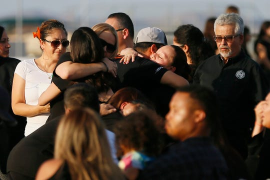 Javier Rodriguez's family greets people as they arrive at a vigil at Horizon High School Aug. 5, 2019. Rodriguez was killed Saturday while shopping with his uncle at Walmart. He attended Horizon last year as a freshman.