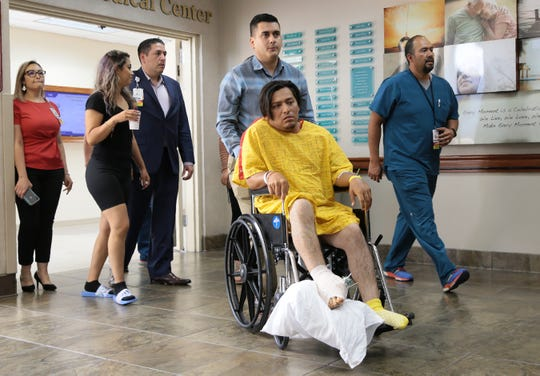Octavio Ramiro Lizarde, 23, is taken to a press conference Tuesday, August, 6, 2019 at Del Sol Medical Center where he is being treated after being shot in the foot in the Walmart attack on Saturday. Lizarde's nephew Javier Amir Rodriguez was killed in the attack.