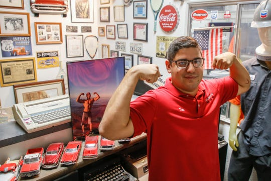 Tito Anchondo poses like his brother Andre at their family's business at 120 N. Piedras St. on Tuesday, Aug. 6, 2019.