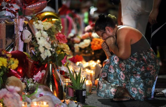 The memorial outside the Walmart in El Paso, Texas, continues to grow as more El Pasoans arrive Monday, Aug. 5, 2019, to leave flowers, pray and light a candle for the victims of the attack Saturday, Aug. 3, 2019, at a Walmart.