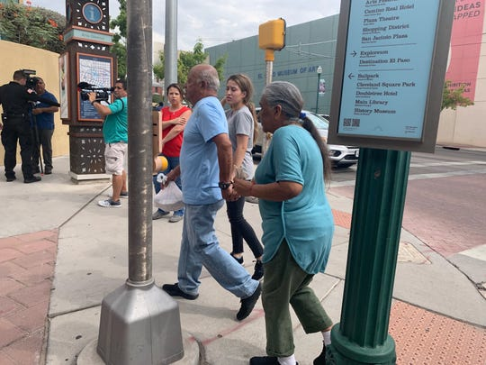 Survivors of the mass shooting at an El Paso Walmart arrive at the convention center Tuesday where people could claim cars left in the parking lot or take advantage of other services.