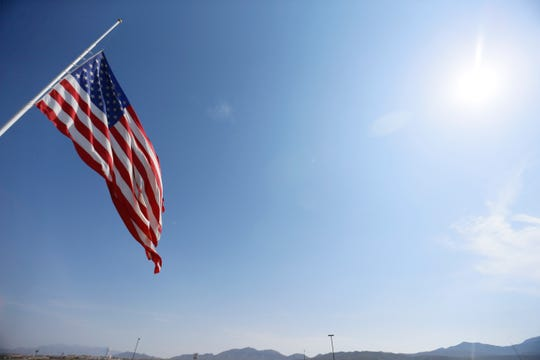 The flag is flown at half-staff outside of Camping World of El Paso Monday, Aug. 5, after the Walmart shootings Saturday, Aug. 3, 2019, in El Paso, Texas.