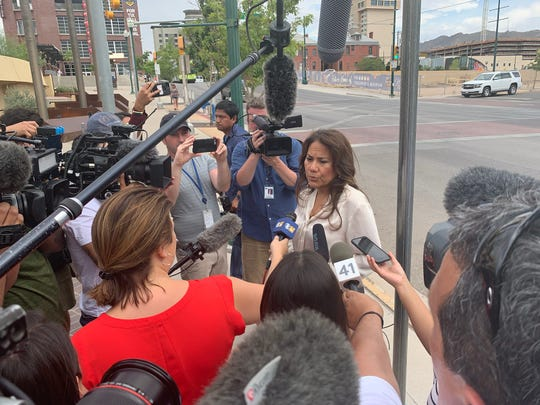 Veronica Escobar speaks to reporters outside the El Paso convention center Tuesday as survivors of the mass shooting at Walmart arrive to claim cars.