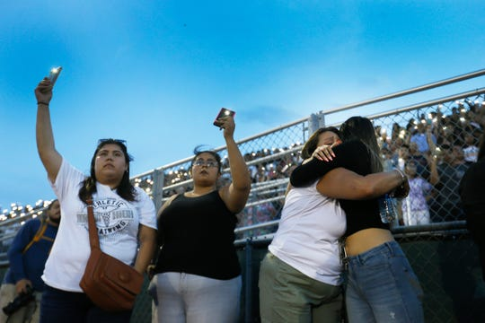 Martha Salas, from left, Mariel Montellano, Ylva Salas and Ashely Almaraz comfort each other during a vigil at Horizon High School for Javier Rodriguez on Aug. 5, 2019. Rodriguez was killed Saturday while shopping with his uncle at Walmart. He attended Horizon last year as a freshman.