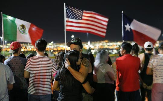 The memorial outside the Walmart in El Paso, Texas, continues to grow Monday, Aug. 5, 2019, as more El Pasoans arrive to leave flowers, pray and light a candle for the victims of the attack at Walmart on Saturday, Aug. 3, 2019, that claimed 22 lives and left 25 others injured.