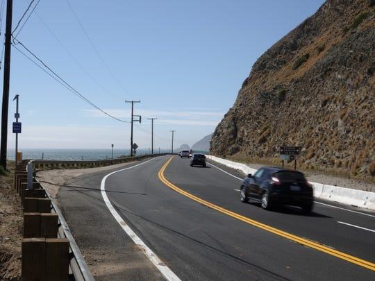 Looking northbound on Pacific Coast Highway from south of Sycamore Canyon Road. Mugu Rock is visible in the middle distance.