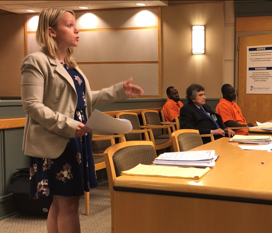 Cumberland County Assistant Prosecutor Lindsey Seidel lays out allegations of evidence tampering against Frank I. Baker III (seated, right) at a detention hearing on Tuesday. Baker, seated with defense counsel Terry Stomel, was ordered held in jail until trial.