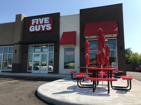 The new Five Guys, a burger and fries restaurant, will open in Rib Mountain on Friday, Aug. 9, 2019. Outdoor seating is available at the location at 1301 Starling Lane off Rib Mountain Drive.