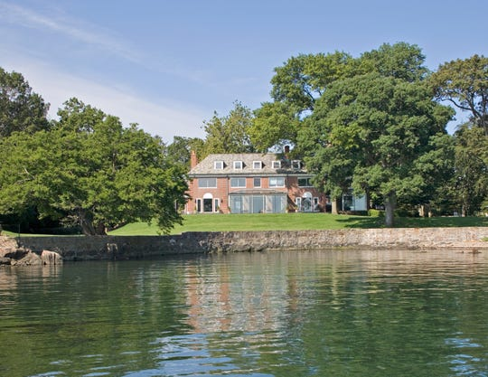 A 1930s Georgian-inspired estate in Larchmont is on the market. The home is on 2.2 waterfront acres