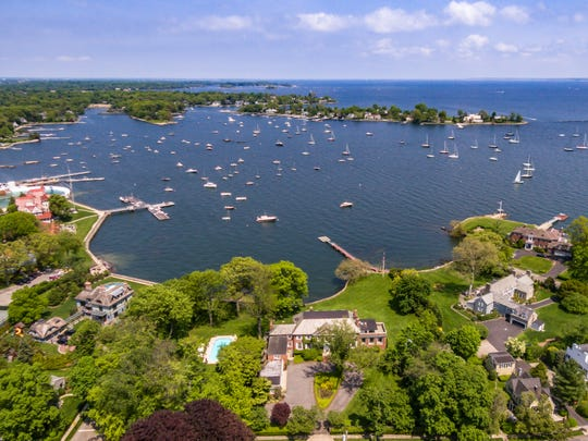 This 1930s Larchmont estate sits on 2 waterfront acres with panoramic views of Larchmont Harbor and Long Island Sound.