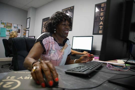 Denise Gaines, a realtor at Century 21 Gold Key Realty, in Newark, works at the office on Main St.