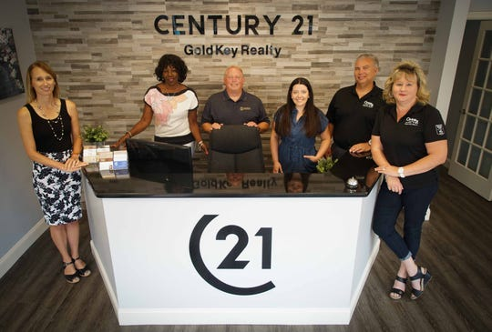 (left to right) Kristen Slijepcevic, Denise Gaines, Jim Benson, Morgan Benson, Ed Wilberg and Lisa Wilberg, all realtors for Century 21 Gold Key Realty in Newark.