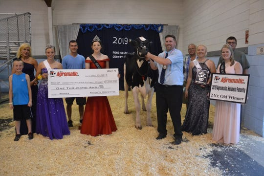 First place and top bred and owned went to Ryan-Vu in the 2-year-old class at the Agromatic Holstein Futurity. Pictured (from left) are Cameron Ryan, representing Ryan-Vu; Judge, Mandy Bue; FDL Co. Fairest of the Fair, Cayley Vande Berg; Trophy Sponsor, Nathan Gillett; Wisconsin Holstein Princess, Lauren Seimers; 2-year old winner Ryan-Vu Jacoby Evette-ET; Leadsman, Brian Kelroy; Trophy Sponsor, Ivan Schuster; Wisconsin Holstein Princess Attendant,  MiKayla Endres; representing, major sponsor Agromatic, Joe Birschbach and 2019 Alice in Dairyland, Abigail Martin.