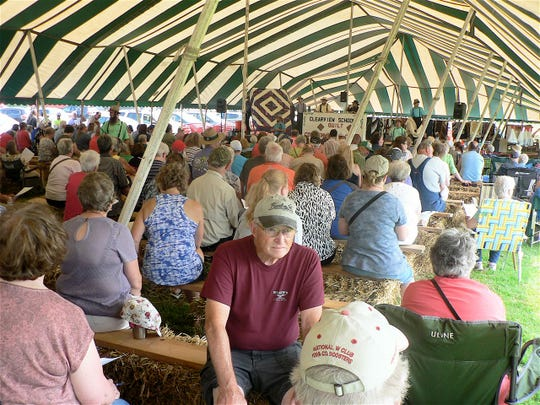 Standing room only inside the jam-packed tent holding the quilt auction.