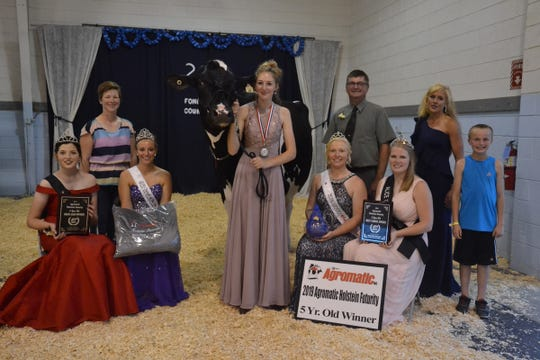 Ryan-Vu Dairy took first place in the 5-year-old class at the Agromatic Holstein Futurity. Pictured (from front left) are Wisconsin Holstein Princess, Lauren Seimers; Cayley Vande Berg, FDL Co. Fairest of the Fair; Wisconsin Holstein Princess Attendant, McKayla Endres; Abigail Martin, 2019 Alice in Dairyland. (back) Sarah Loehr, Trophy Sponsor;  Ryan-Vu Chelios Mocha ; Leadsperson, Kaitlyn King; Joe Birschbach, representing major sponsor Agromatic; Judge, Mandy Bue; Cameron Ryan, Representing Ryan-Vu.