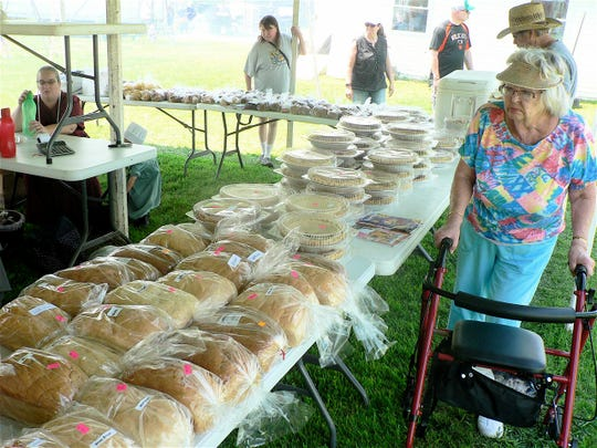 Tables filled with homemade bread and pies are a big treat for many buyers.