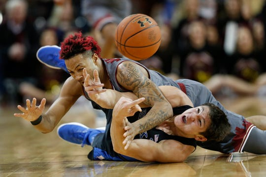 Duke Blue Devils guard Grayson Allen (3) and Boston College Eagles guard Ky Bowman (0) battle for a loose ball during the first half at Silvio Conte Forum.